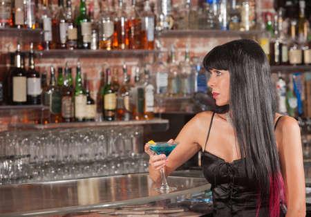 Seus beautiful woman at a bar looking up Stock Photo - 17591126