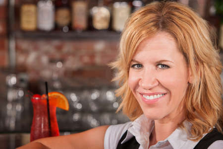 Close up of blond woman in cafe with drink Stock Photo - 17591139
