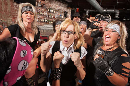 Motorcycle gang members force a fight with nerd in bar photo