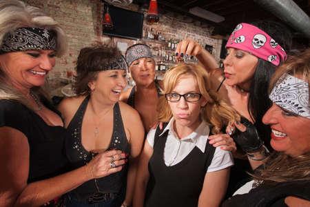 shy woman: Cruel gang of mature women teasing a nerd in a bar
