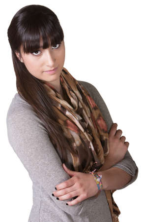 Serious young Hispanic female with folded arms over white Stock Photo - 17703252