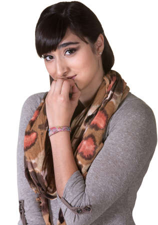 Apologetic mixed woman with scarf biting fingernails Stock Photo - 17703259