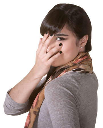 coy: Coy Hispanic female hiding part of face with hand