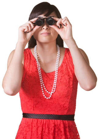 Serious woman in red looking through jewelers glasses Stock Photo - 17801508