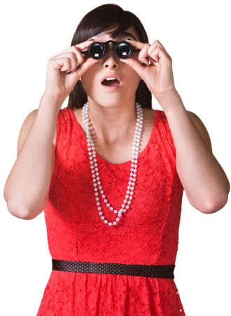 Surprised lady looking through jewelers glasses over white photo