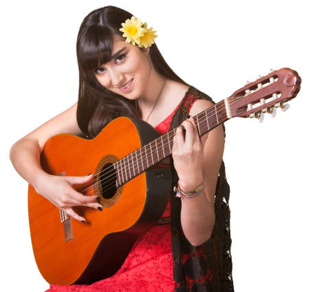 playing folk: Pretty young woman playing a guitar over an isolated background Stock Photo