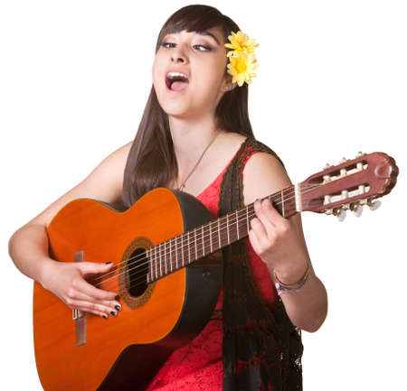 Young woman with cross eyes playing guitar and singing photo
