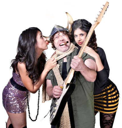Rock guitar player with two beautiful female fans photo
