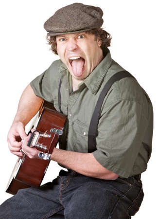 Young Caucasian Guitarist sticking out his tongue