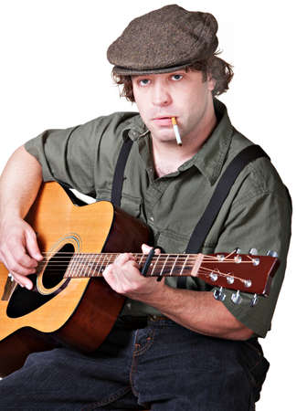 Serious guitarist with cigarette over white background Stock Photo - 17991542