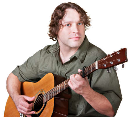 easygoing: Easygoing male guitarist playing music over white background