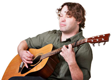 Serious man with eyes closed playing a guitar Stock Photo - 17991561