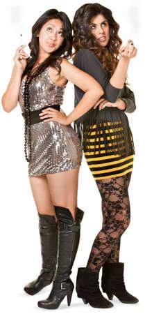 arrogant: Club girls in mini skirts holding cigarettes