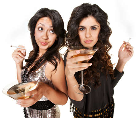 Bored young women with martinis and cigarettes  Stock Photo - 17991536
