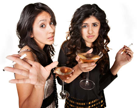 misbehaving: Rude club girls with cigarettes and martinis over white background