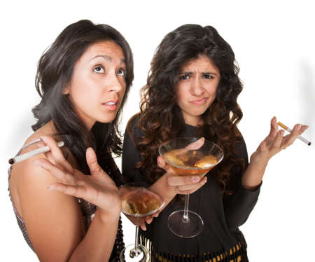 Young annoyed club girls in fashionable clothes with drinks Stock Photo - 17991546