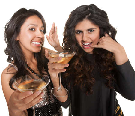 Pair of cute women holding martinis with a call me gesture Stock Photo - 17991555
