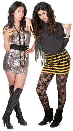 Cute Hispanic sisters in mini skirts admiring something Stock Photo - 17991538