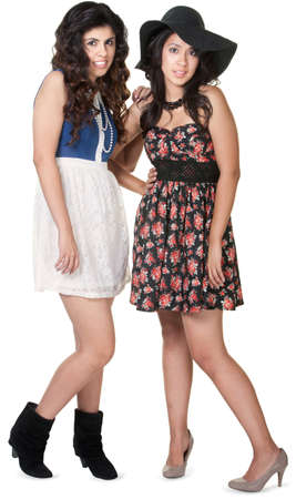 Mexican sisters together over isolated white background Stock Photo - 17991548