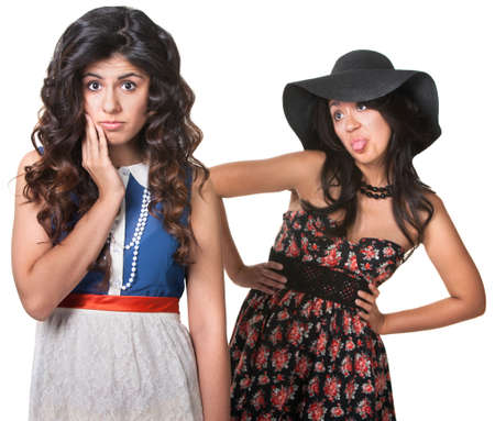 Young woman sticking her tongue out behind friend Stock Photo - 17991560