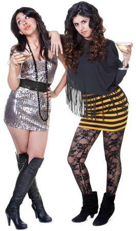 conceited: Sassy Hispanic club girls in mini skirts with martini drinks Stock Photo