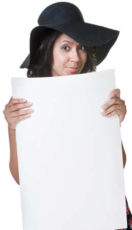 Cheerful young lady with hat holding white poster photo