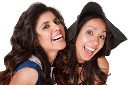 Laughing Hispanic sisters over isolated white background Stock Photo - 18123506