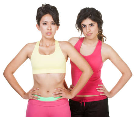 Cute Latina sisters in workout clothes on white background Stock Photo - 18123510