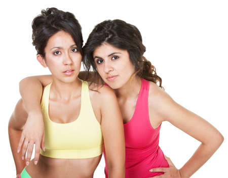 Serious pretty female friends it fitness clothing over white Stock Photo - 18123500