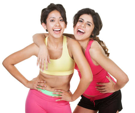 Giggling young latina workout women on white background Stock Photo - 18123493