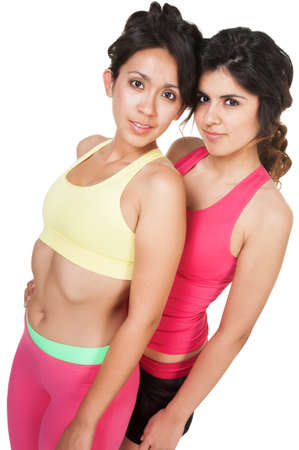Two pretty young athletic women on isolated background photo