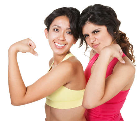 Smiling fit female friends flexing their biceps Stock Photo - 18123497