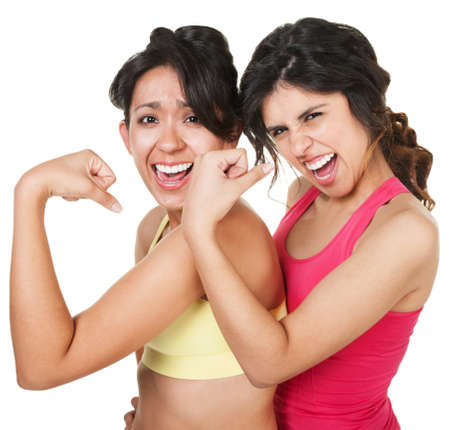 Giggling young athletic women flexing their biceps photo