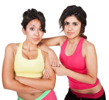 Confident fit young Hispanic friends together on isolated background Stock Photo - 18123498