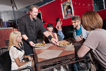 Hipster group served pizza by mobile cafe chef Stock Photo - 18123505