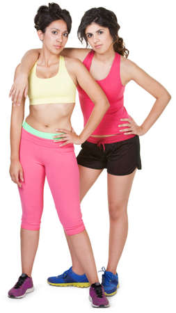 Latina siblings in workout clothes on white background photo