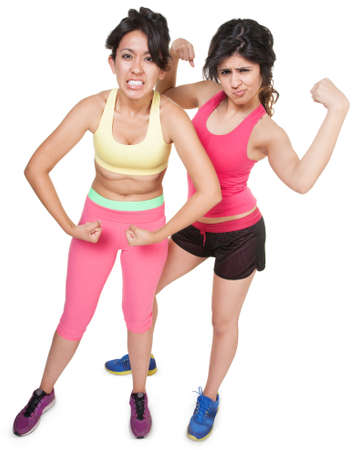 Cute Latina sisters flexing muscles over white background photo