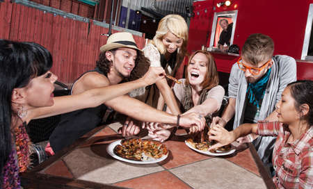 woman eat: Group of happy people eating out at mobile restaurant