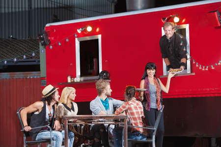 food service: Cheerful group of customers with pizza orders from canteen Stock Photo