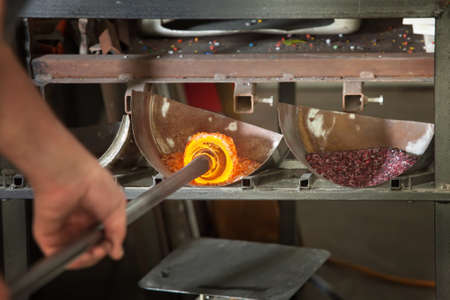 molted: Iron rod with molten glass placed in colored stones