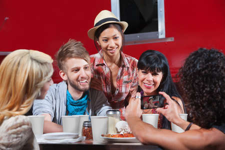 dining out: Friends smiling for photos at restaurant