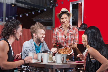 Five laughing friends sharing plate of pizza Stock Photo - 18607074