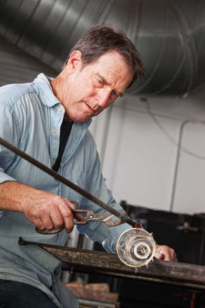 Skilled artisan concentrating on glass art object Stock Photo - 18607076