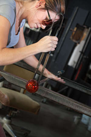 Serious industrial artist finishing glass art object Stock Photo - 18607192