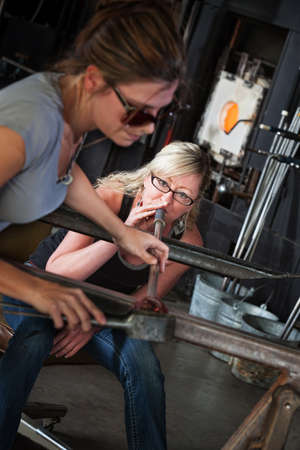 Female glass art students working together on object Stock Photo - 18606977