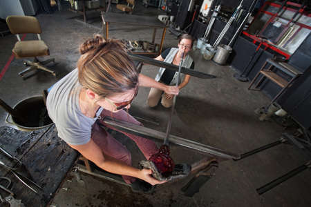 Apprentice and glass artisan creating fine art glass Stock Photo - 18607079