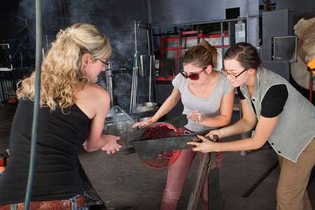 Three Caucasian women working on glass art creation Stock Photo - 18607066