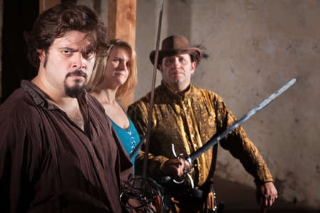 swashbuckler: Three tough sword fighters in a dungeon Stock Photo