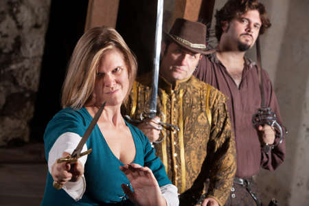 smirking: Tough smirking medieval woman with dagger and friends
