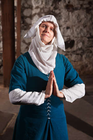 a righteous person: Righteous medieval nun with palms together in prayer